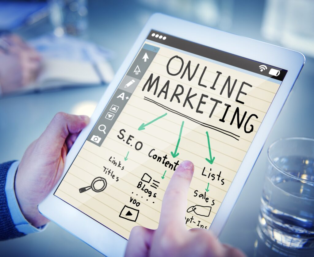 Knowledge process outsourcing industry with a hand holding a tablet showing an image of online marketing