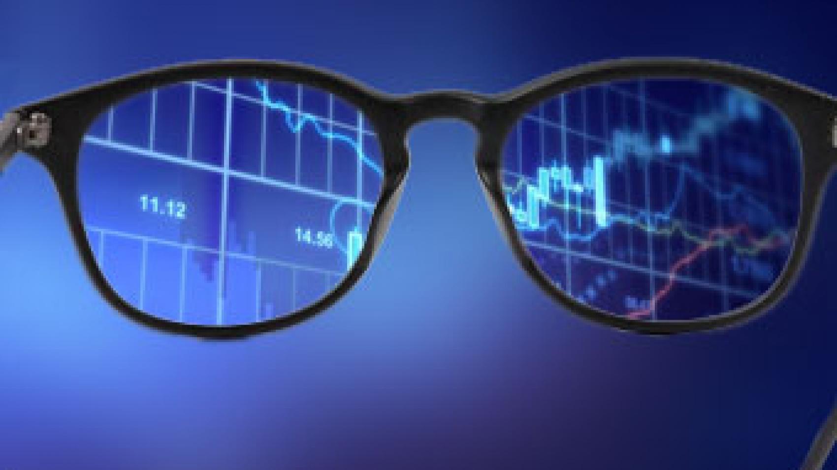 eyeglasses reflecting a graph