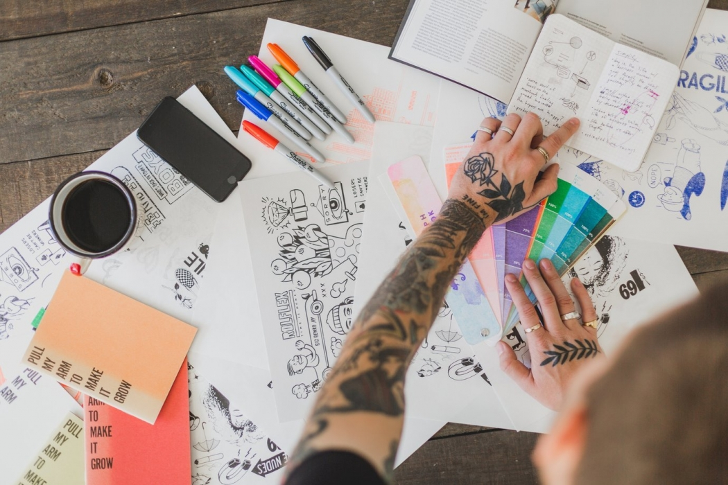 A graphic artist offering graphic design services as part of outsourcing services
