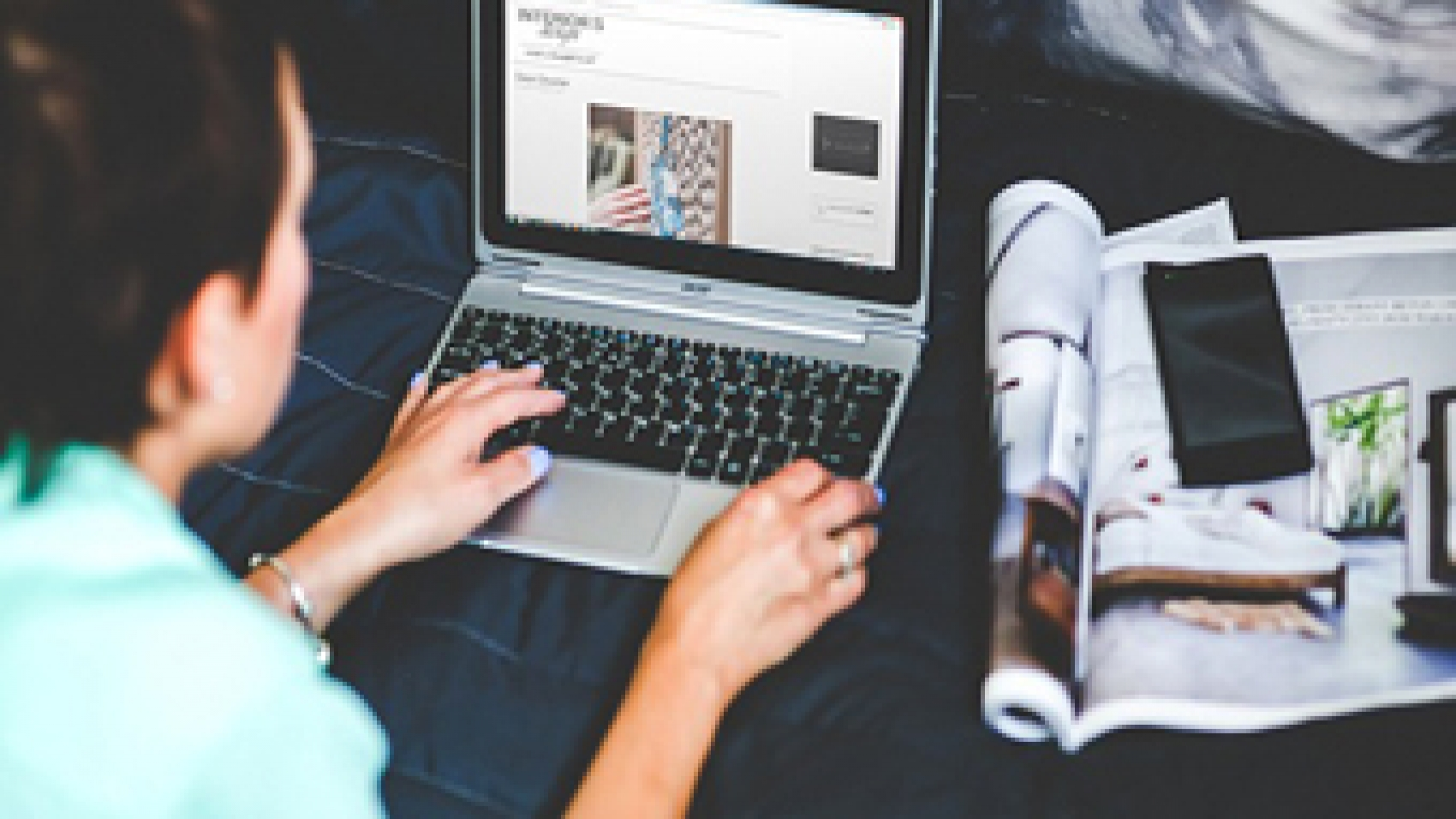 A Woman Reading an Blog on Her Laptop