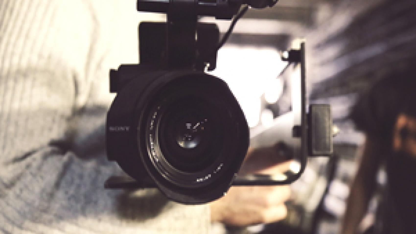 a man filming a video