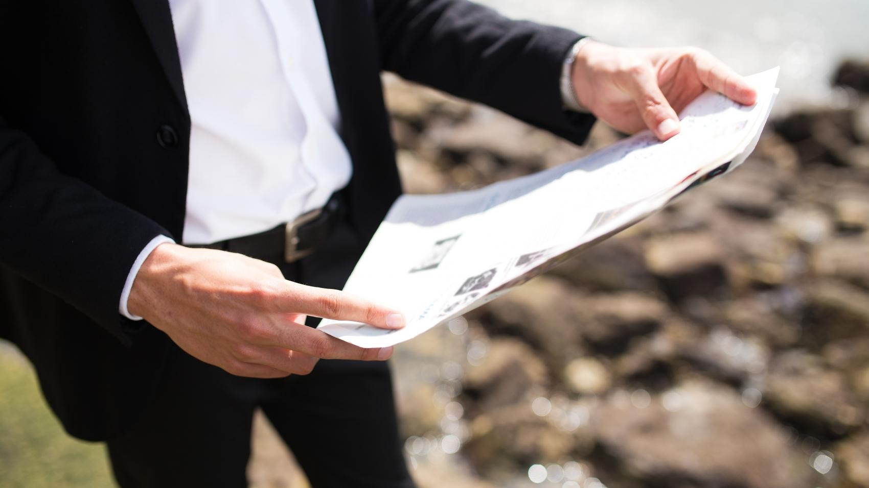 businessman using guide