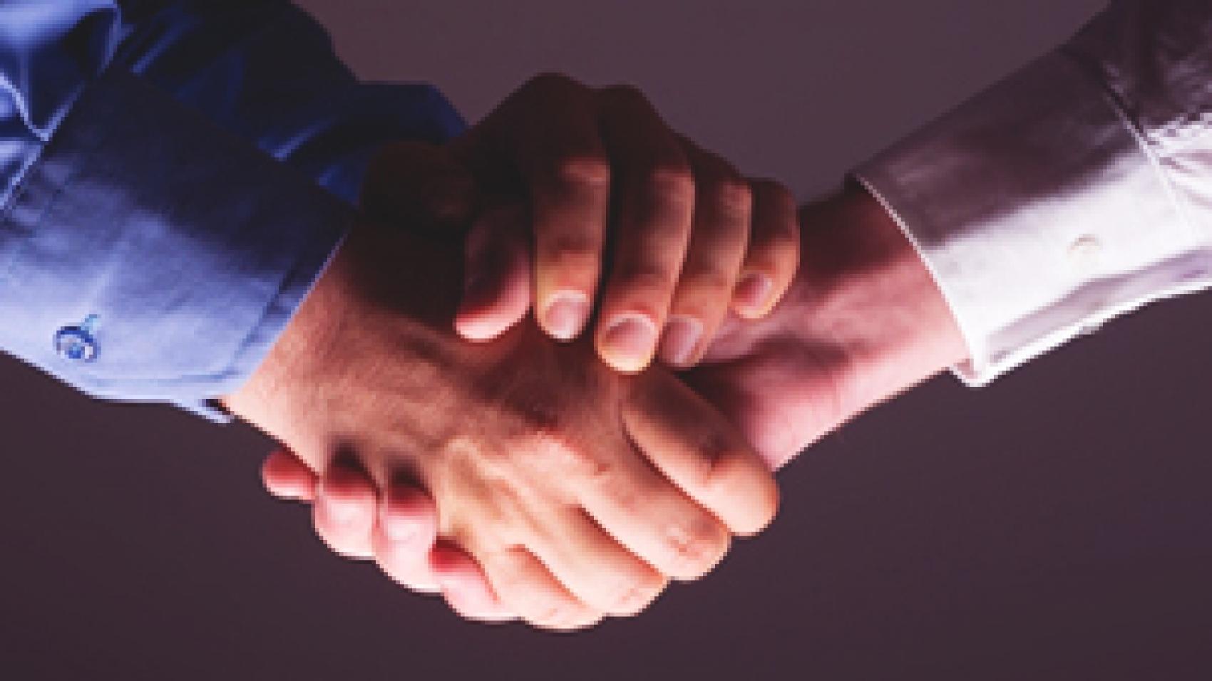 outsourcing partner shaking hands