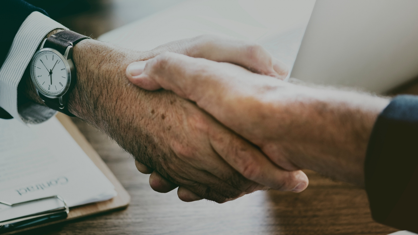 a meeting closed with a hand shake