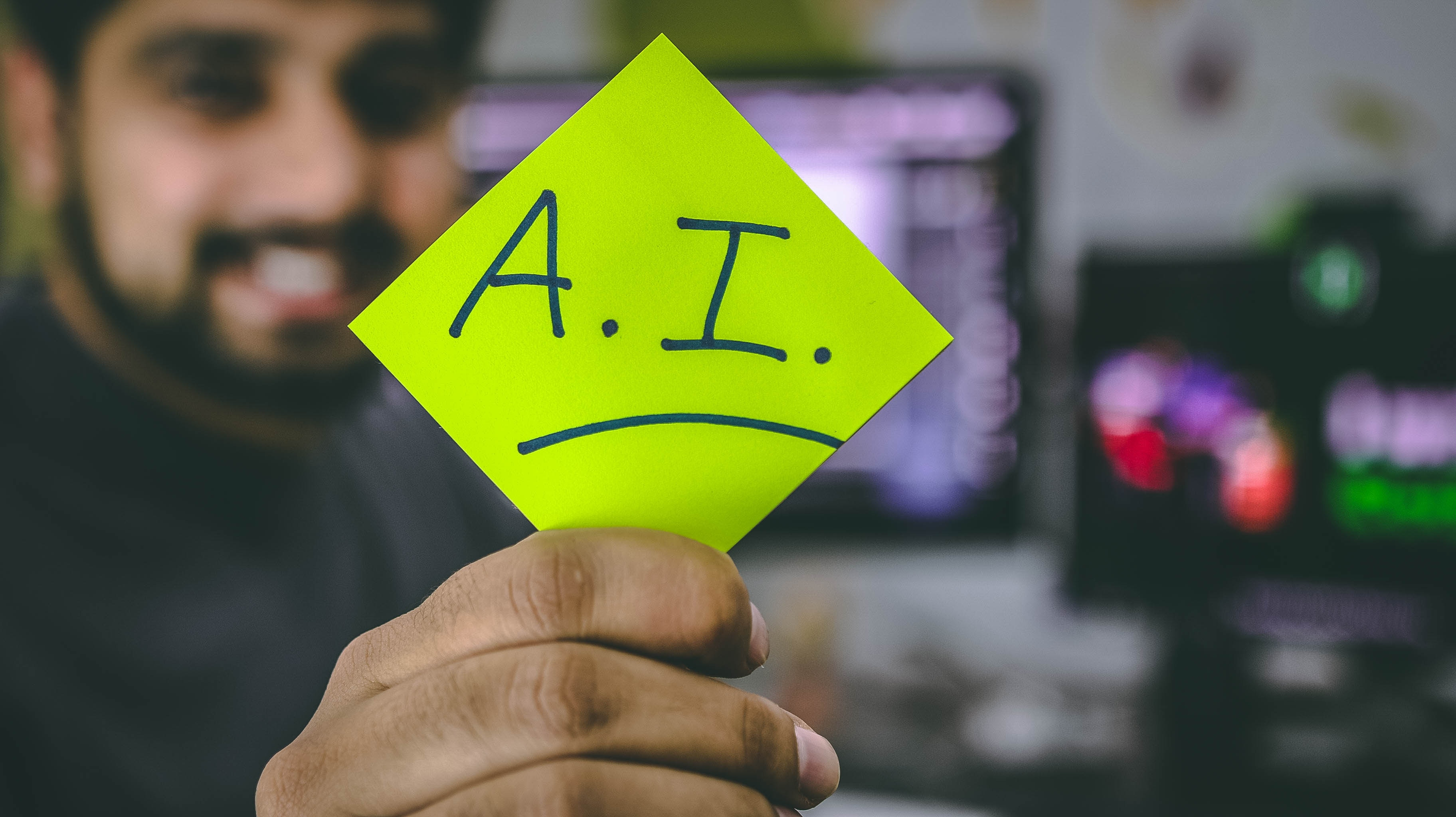 AI written on a sticky note - artificial intelligence