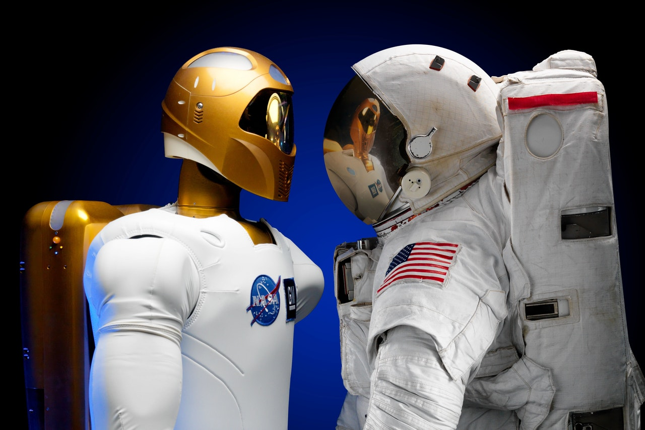 human astronaut vs robonaut - artificial intelligence