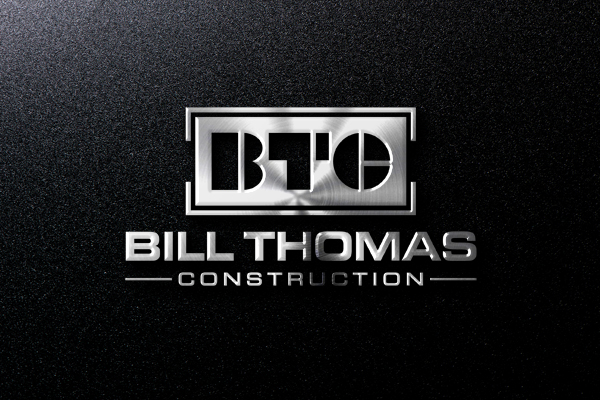 A metal btc letter logo for bill thomas construction