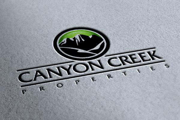 A logo of a mountain for canyon creek