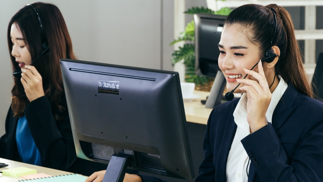 Two female customer service agents showing what is BPO and its services
