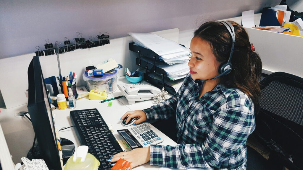 female virtual assistant managing emails and calls