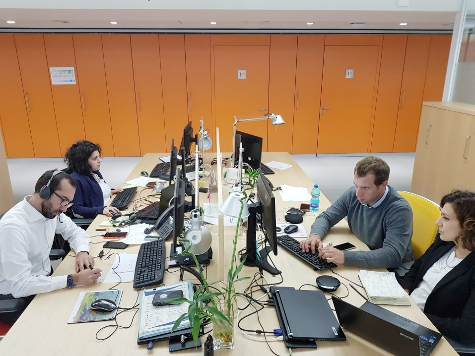 Four professionals working on outsourcing services in the office