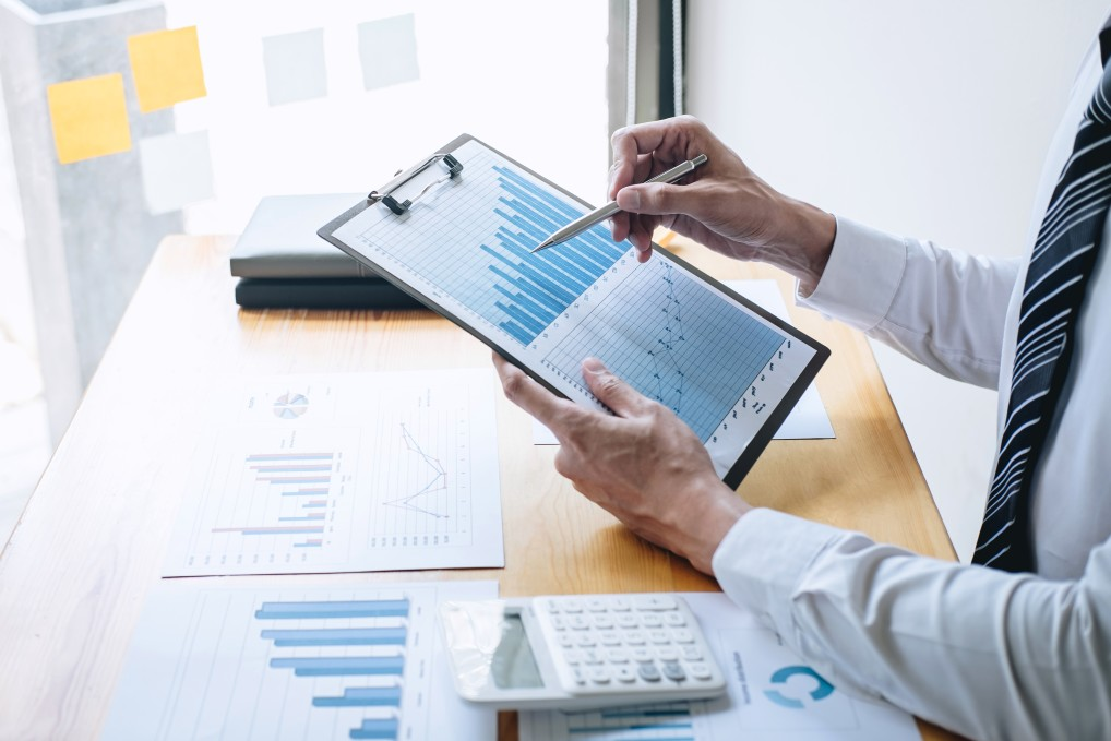 Accountant analyzing and calculating cash flow and expenses