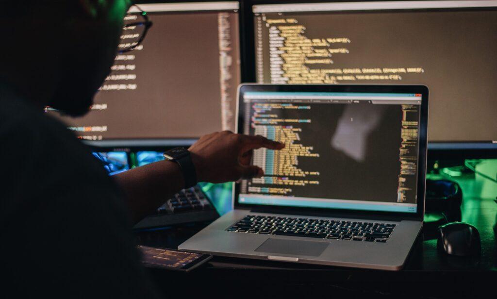 programmer handling IT outsourcing services tasks