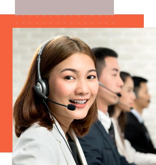 Filipino female answering service representative taking a call