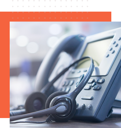 Corporate phone and headset used by a teleservice specialist